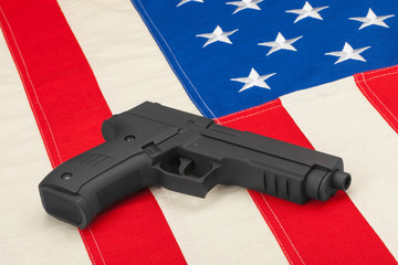 Handgun laying on USA flag - studio shoot
