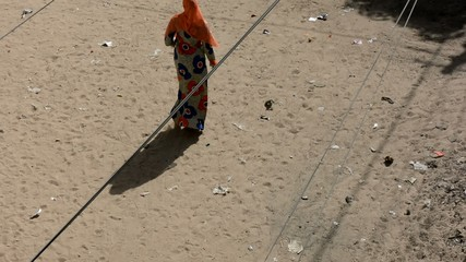 African woman walking in the streets of Dakar