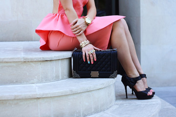 fashionable woman legs in shoes high heels and handbag outdoor