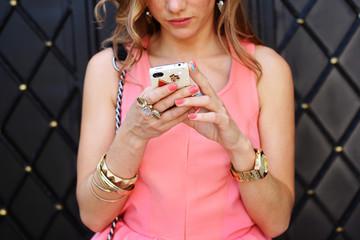 fashion woman using a smartphone outdoor closeup