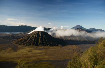 Active volcano crater with smoke, Bromo, Indonesia