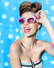 Young attractive laughing woman wearing sunglasses