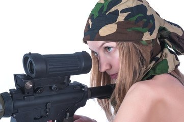 Beautiful young woman aims on sniper rifle