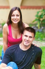 Young happy couple having fun in the garden