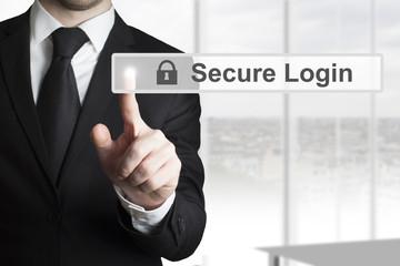 businessman pushing touschscreen secure login