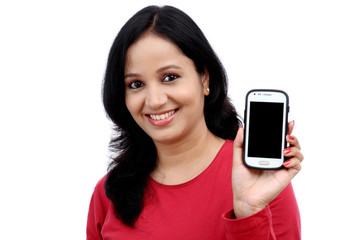 Young woman holding mobile phone