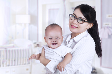 Asian businesswoman and her baby 2