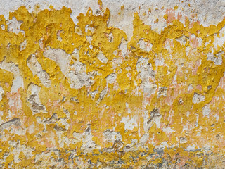 Worn stucco texture in a old wall.