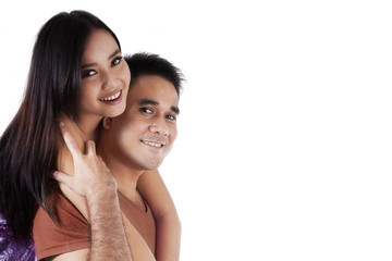 Attractive asian couple in studio