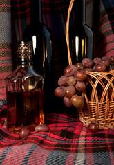 Cognac, Wine, Grapes on the Tartan Fabric