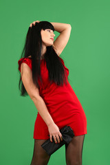 Young woman wearing red dress with emotions