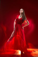 Independent beautiful lady wearing long red dress