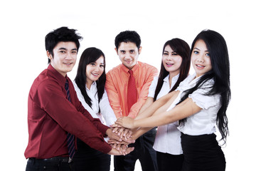 Business team joining their hands together isolated