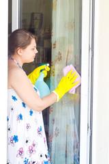 Young girl washing windows
