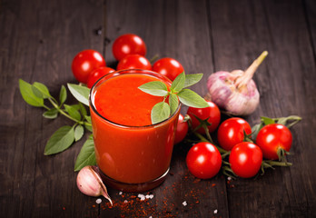 Tomato juice glass with basil and tomatoes