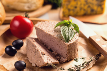 Duck pate on plate with basil
