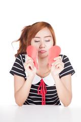 Sad Asian girl tear heart shape paper