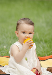 Baby eating oranges