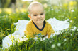little child lying on a diaper the grass