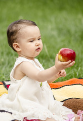 Cute toddler giving an apple