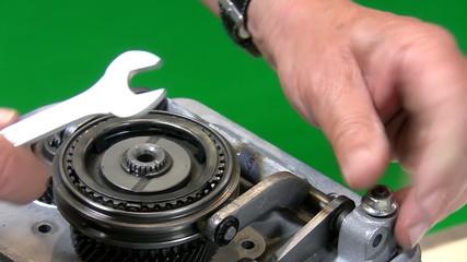 Mechanic dismantling gear box 2.