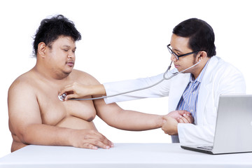 Doctor is checking a fat man 1