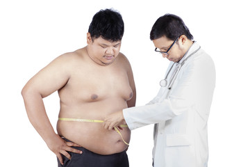 Doctor measuring a patient obesity 1