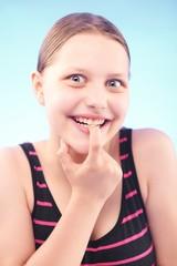 Teen girl grimacing