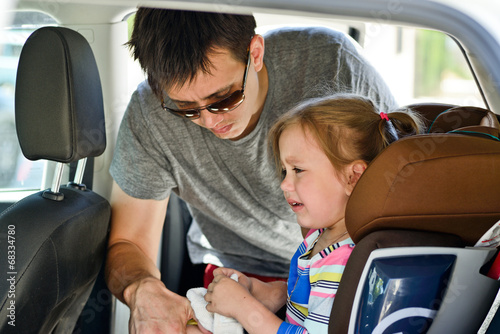 father fastening daughter