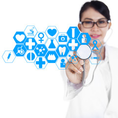 Female doctor using modern technology 1