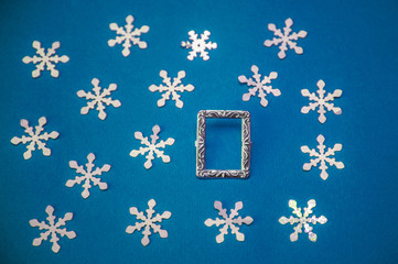 Christmas card with frame and snowflakes on a blue background
