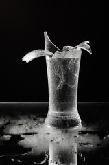 Shattered beer glass isolated on the dark background