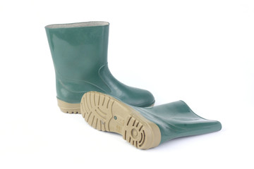 A studio shot of a green rubber boots isolated on white