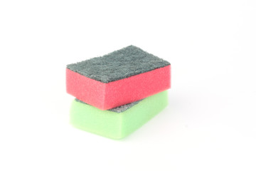 Two red and green sponges on white background