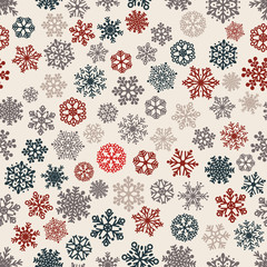 Seamless pattern of snowflakes, multicolored on white