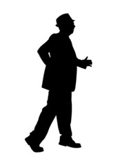 Silhouette of a Man Walking Fast