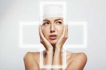 woman touching bandaged head.