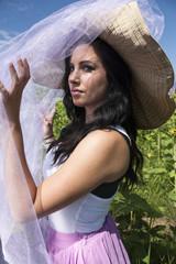 Brunette woman wearing big hat
