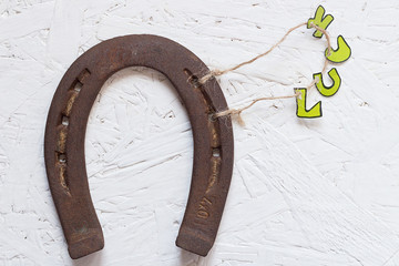 Rusty Horseshoe and Luck Letters