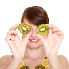 Girl in fruit necklace covering eyes with kiwi