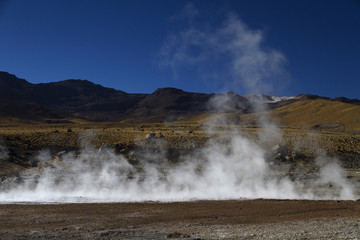 steam with mountain landscape at El Tatio Chile