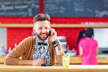 man talking the mobile phone in cafe