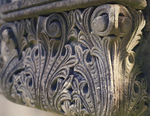 Detail of intricate carving with fleur de lis design