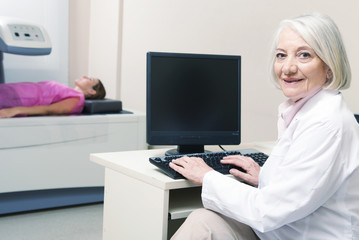 Senior female doctor analyzing results of woman patient at bone