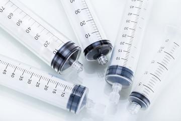 Syringe on a white background