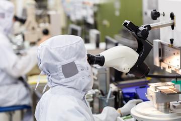 Operator in factory use microscope