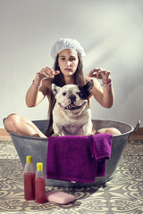 Woman washing a dog.
