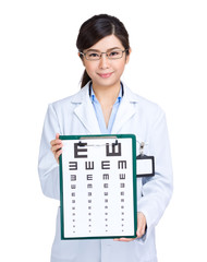 Optician with eye chart