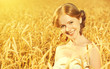 beautiful happy girl in wheat field in summer
