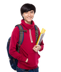 Student with backpack and handbook